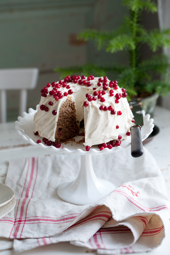 Gluten free gingerbread bundt cake with lingonberries & Vanilla goat cheese frosting