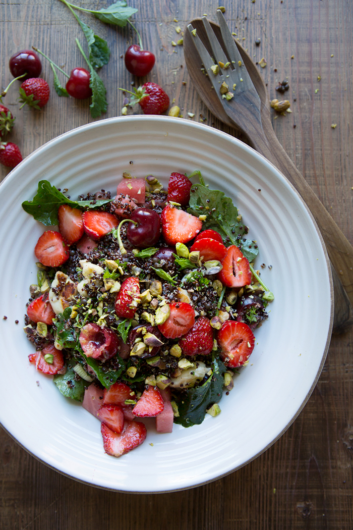 A black quinoa summer salad with baby kale, haloumi, red ...
